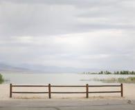 Lake shore fence stock photography