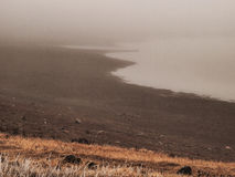 Lake shore in the fog Royalty Free Stock Images