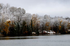 Lake shore after late fall snow Stock Photography