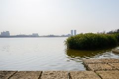 Lake shore made of square stone columns in sunny winter afternoon. Chengdu,China stock photo