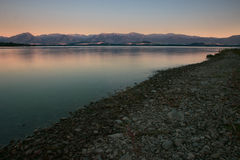 Lake Shore with Mountains Royalty Free Stock Image