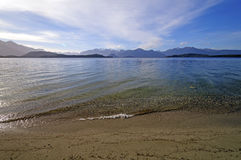 Lake Shore and Mountains on a Sunny Day Stock Photography
