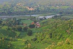 Lake shore, small rural vilage. Beautiful natural view of lake, green trees, green mountain and some rural house of village. this view of near kagdi pick up lake Stock Image