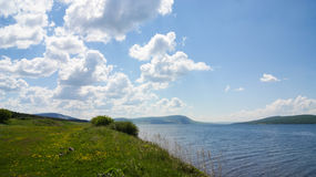 Lake shore in a sunny day royalty free stock photography