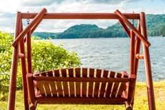 Lake side swing. Peaceful wooden swing, lakeside on an  earlier summers eve Royalty Free Stock Photos
