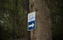 Lake sign. A sign showing the direction to a lake Royalty Free Stock Photo