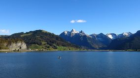 Lake Sihlsee and snow capped mountains. Autumn scene Stock Photos