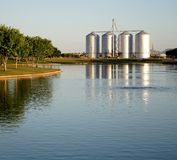 Lake with Silos in the Background. Four silos behind a lake at a park in Gilbert Arizona Stock Images