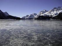 Lake of Silvaplana. Frozen lake of Silvaplana with mountain landscape in Switzerland Royalty Free Stock Images