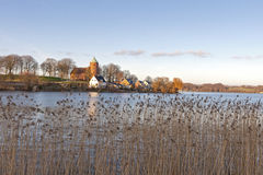 The Lake at Skanderborg. Denmark. The Castle Church on the hill. Shot taken just before sunset Royalty Free Stock Image