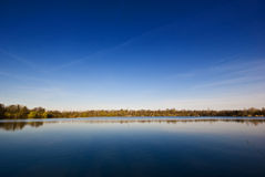 Lake and Sky. Here you can see a lake in the foreground and a big blue sky in the background royalty free stock image