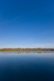 Lake and Sky. Here you can see a lake and a blue sky stock image