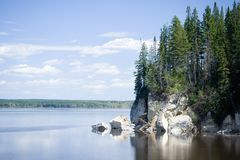 Lake and sky. Lake, sky, clouds, forest, reflections. Ural. Russia Royalty Free Stock Photos