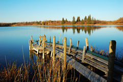 Lake and sky. Autumn view of the serene astotin lake, blue sky and shore reflections in elk island national park, edmonton, alberta, canada stock image