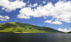 Lake & sky. Lake with blue cloudy sky, Bulgaria royalty free stock photography