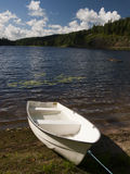 Lake with small boat Royalty Free Stock Photo