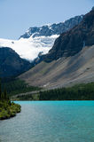 Lake in snow capped mountains, Rockies, Canada Stock Photos