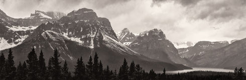 Lake and snow capped mountains on stormy day Royalty Free Stock Image
