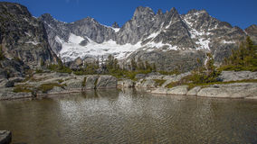 Lake in Snow Covered Mountains Royalty Free Stock Photos