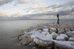 Lake snow covered rocks 1 Stock Photography
