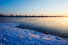 The lake and snow sunrise Royalty Free Stock Image