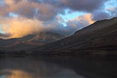 Lake in Snowdonia National Park with Mount Snowdon In the background at sunrise