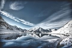 Lake on Between Snowy Mountain Stock Images