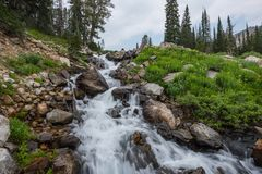 Lake Solitude Empties into Cascade Creek. Through waterfall Royalty Free Stock Photo