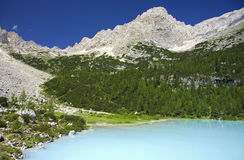 Lake Sorapis of the Dolomites. The crystal blue waters of Lake Sorapis in the Dolomites of Northern Italy stock images