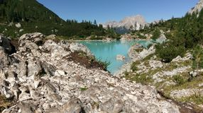 Lake Sorapis, Dolomites Mountains, Italy. Blue waters of Lake Sorapis in Dolomites Mountains of Italy with blue skies Royalty Free Stock Images