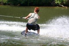 Lake Sport. Teenage boy wakeskating on the lake Royalty Free Stock Photo