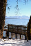 Lake Starnberger See in Bavaria, Germany. The mountain range in the background are the European Alps. The picture was taken on a beautiful winter day Royalty Free Stock Photography