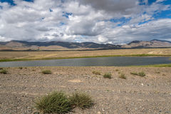Lake steppe sky clouds mountains Stock Images