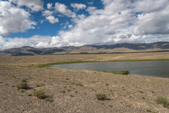 Lake steppe sky clouds mountains Stock Image