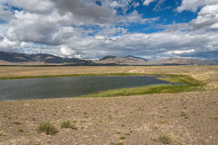 Lake steppe sky clouds mountains Royalty Free Stock Images