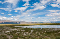 Lake steppe sky mountains clouds Royalty Free Stock Photo