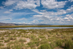 Lake steppe sky mountains clouds Stock Photo
