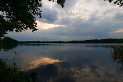 Lake. Stormy clouds over a lake Royalty Free Stock Photos