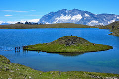 Lake with a strange shape island in the italian alps Stock Photo