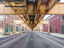 Lake Street underneath the elevated train in the Fulton Market neighborhood. Main streets in Chicago, streets in Illinois. Lake Street underneath the elevated royalty free stock images