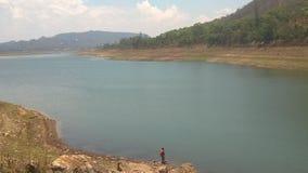 Lake. Subsistence fishing in the Mazowe Dam Stock Image