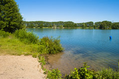 The Lake. Summer - sunny day - blue lake - clear sky - trees - little beach Stock Photography