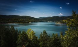 Lake during summer sunny day. Mountain lake during summer sunny day with clear blue sky stock photo