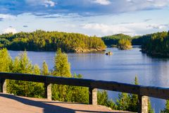 Lake summer view with reflection of clouds on water, Finland Royalty Free Stock Photo