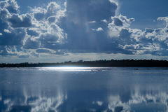 Lake with sun reflection Stock Image