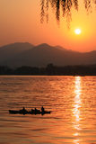 lake sun setting Stock Images
