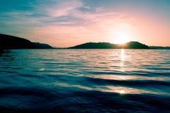 Lake sunrise Stock Images