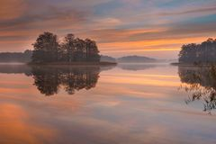 Lake sunrise Stock Photos