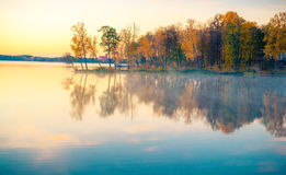 Lake at sunrise in fall Stock Photos