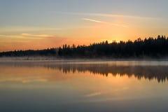Lake sunrise fog peach Stock Photo